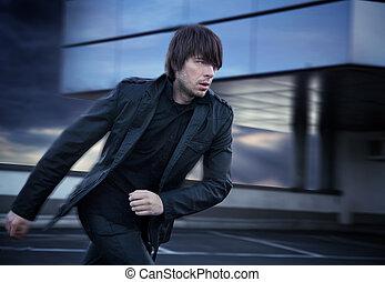 Elegant handsome man running
