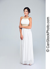 Elegant happy woman in white dress