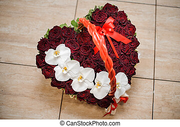 Elegant heart-shaped box with a flower composition of pink...