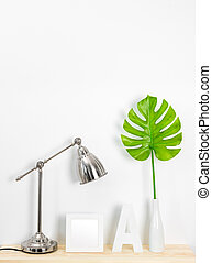 Elegant home decor with metal lamp and tropical leaf
