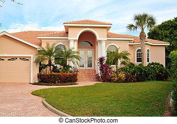 Elegant home, with huge archway covering double door...
