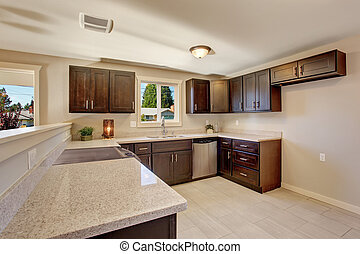 Elegant kitchen with stained cabinets.