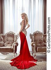 Elegant lady. Beautiful blond woman model in fashion dress...