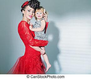 Elegant lady carrying her lovely daughter - Elegant lady...