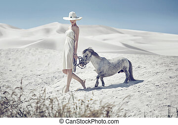 Elegant lady with the cute pony
