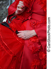 elegant lady with vintage style red dress and a black fan