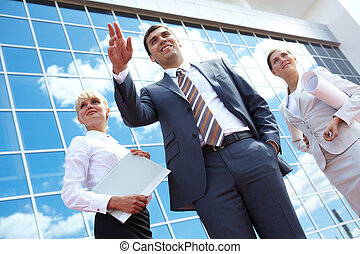 Elegant leader - Below angle of successful partners with...