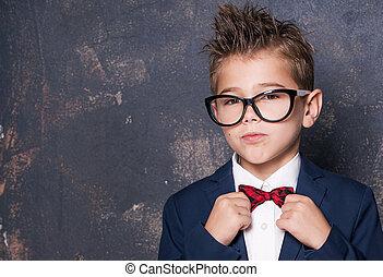 Elegant little boy in suit.