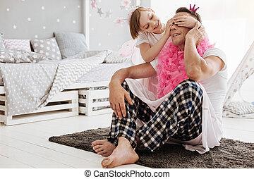 Elegant little girl enjoying playing with her dad