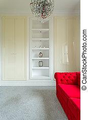 Elegant living room interior with red sofa