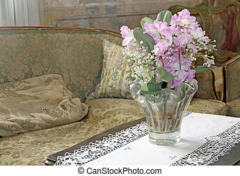 elegant lounge for nobles within a late 18th century villa with a vase of fresh flowers