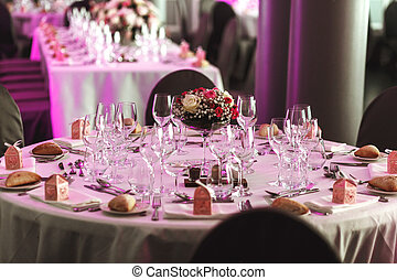 Elegant luxury cutlery and tablewear with flowers at hotel wedding reception
