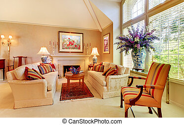 Elegant luxury living room with fireplace and large window.