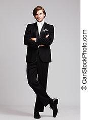 elegant man - elegant young man in black tuxedo, full body...