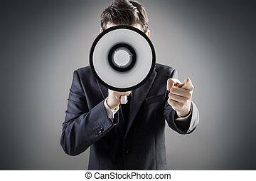 Elegant man holding a huge megaphone