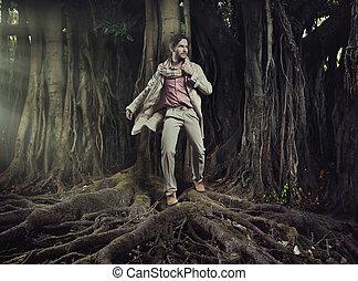 Elegant man on nature background - Elegant young man on...