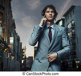 Elegant man posing on a city street