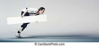 Elegant man running with a white board