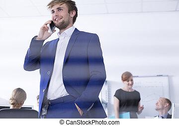 Elegant man talking on the phone