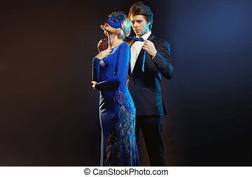elegant man tying the blue mask - elegant man tying the ...