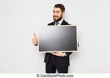 elegant man with blackboard on white