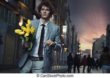 elegant, mann, halten blüten
