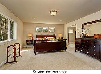 Elegant master bedroom with wooden bed frame.