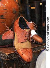Elegant men shoes in a window store.