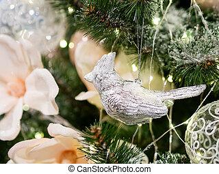 Elegant metal bird on silver thread, New Year decoration for Christmas tree.