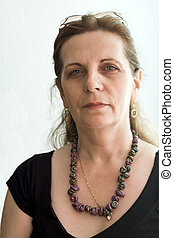 Portrait of elegant and beautiful middle age woman