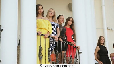 Elegant models posing on the stairs outside