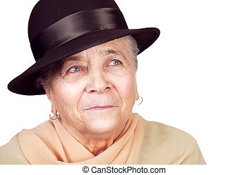 Elegant old senior woman with hat