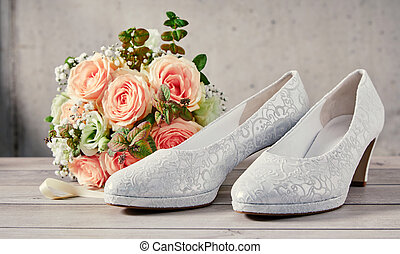 Elegant patterned white classic court shoes for a bride at...