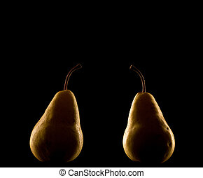 Elegant pear isolated on black background with backlighting.