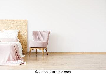 Elegant pink chair in flat