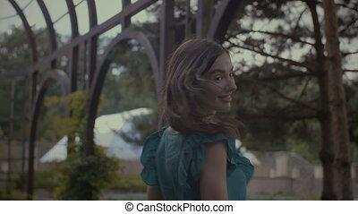 Elegant pretty woman flirting with man in park
