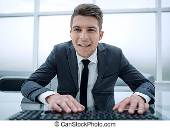 Elegant professional businessman working on computer looking at