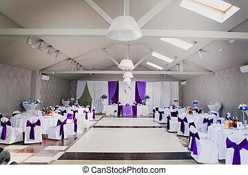 Elegant restaurant room before wedding party, horizontal. Purple, violet tableware