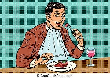 Elegant retro man eats in the restaurant and drinking wine