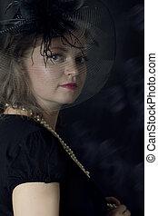Elegant retro woman in veil