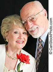 Elegant Senior Couple with Rose