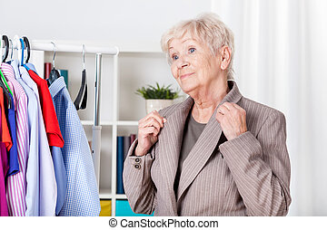 Elegant senior woman getting ready to leave