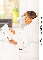 elegant senior woman reading a book