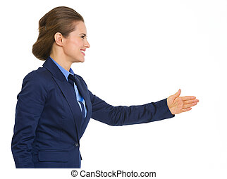 Elegant, smiling business woman in profile going to shake hands