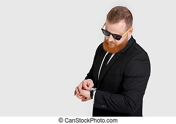 Business man looking at watch