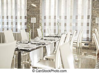 Elegant table set in a modern style dining room interior