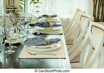 elegant table set in classic style dining room interior