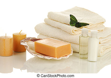 Elegant toiletries - A bar of natural soap with bath towels ...
