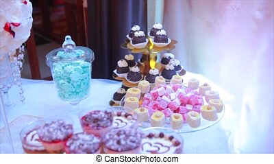 Elegant wedding candy bar table catering arrangement.