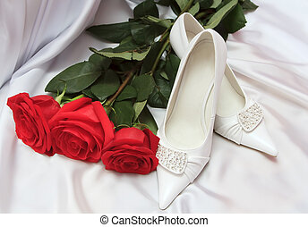 Elegant wedding shoes with red roses